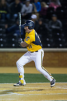 Patrick Ferguson (38) of the Kent State Golden Flashes follows through on his swing against the Wake Forest Demon Deacons in game two of a double-header at David F. Couch Ballpark on March 4, 2017 in  Winston-Salem, North Carolina.  The Demon Deacons defeated the Golden Flashes 5-0.  (Brian Westerholt/Four Seam Images)