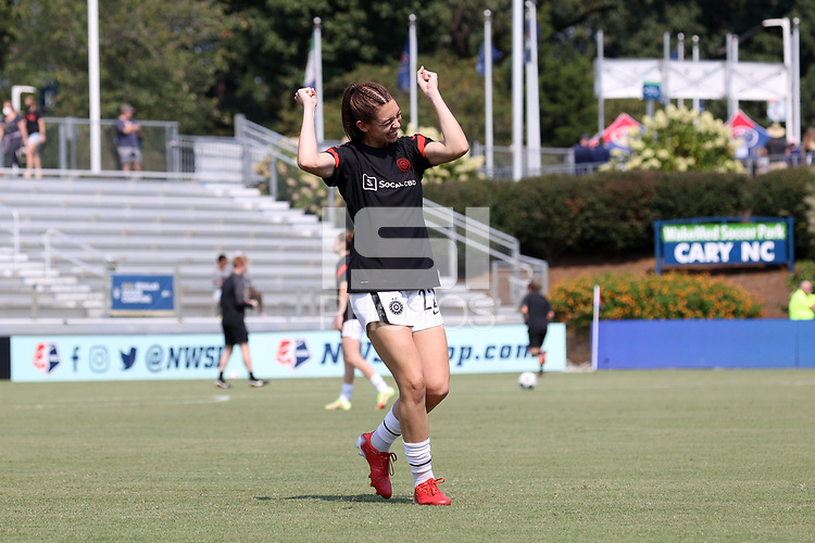 CARY, NC - SEPTEMBER 12: Morgan Weaver #22 of the Portland Thorns FC reacts after playfully kicking a teammate before a game between Portland Thorns FC and North Carolina Courage at Sahlen's Stadium at WakeMed Soccer Park on September 12, 2021 in Cary, North Carolina.