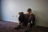 Los Angeles, California<br /> January 29, 2014<br /> <br /> WWII former homeless veteran Ivan Bennett, 85 was placed in a VA voucher apartment a few days before he received donated furniture. He sits alone waiting for the furniture. Loneliness from the street is a severe issue in dealing with placing homeless vets in permanent housing.