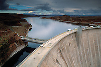 Storm clouds over the top of Glen Canyon Dam and Lake Powell, near Page, Arizona.