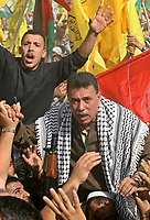 "Leader Fatha in Gaza Ahmaed Heles and Thousands of Palestinian Fatah supporters gather at a rally marking the third anniversary of the death of the late Palestinian leader Yasser Arafat in Gaza City, Monday, Nov. 12, 2007. Hamas security forces opened fire at a mass rally commemorating the death of the late Palestinian leader, violently dispersing the largest public display of support for the rival Fatah movement since Hamas seized control of the Gaza Strip in June. Five people were killed and at least 31 were wounded, medical officials and Fatah said.""photo by Fad Adwan"""