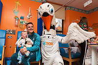 Thursday 21 December 2017<br /> Pictured: Roque Mesa of Swansea City and Cyril the Swan<br /> Re: Swansea City Childrens Ward Visit, Morriston Hospital, Swansea, Wales, UK
