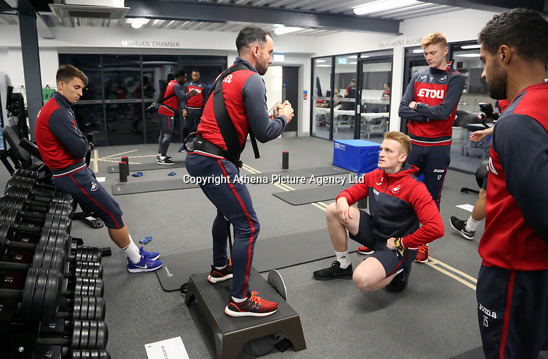 Leon Britton (C) exercises in the gym during the Swansea City Training at The Fairwood Training Ground, Swansea, Wales, UK. Wednesday 22 November 2017