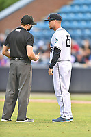 Asheville Tourists manager Nate Shaver (25) discusses balk call with umpire Tyler Witte during a game against the Bowling Green Hot Rods on May 28, 2021 at McCormick Field in Asheville, NC. (Tony Farlow/Four Seam Images)