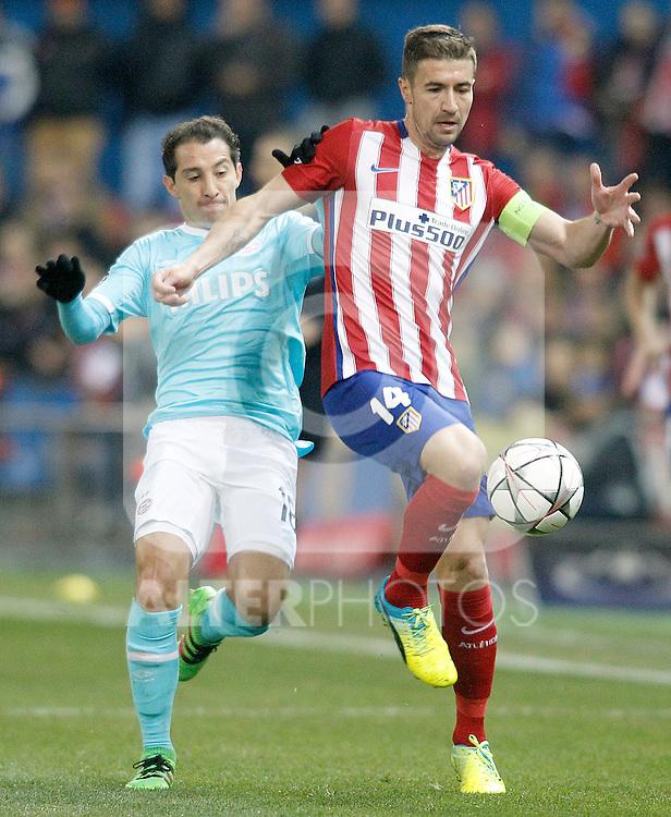 Atletico de Madrid's Gabi Fernandez (r) and PSV Eindhoven's Andres Guardado during UEFA Champions League match. March 15,2016. (ALTERPHOTOS/Acero)