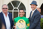 HALLANDALE BEACH, FL- MARCH 19: Shug McGaughey (left) presents the trophy to jockey Paco Lopez and trainer Kelly Breen after Stonetastic #8 won the Inside Information Stakes at Gulfstream Park on March 19, 2016 in Hallandale Beach, Florida. (Photo by Arron Haggart/Eclipse Sportswire/Getty Images)