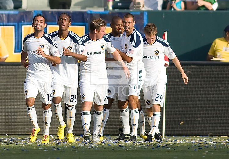 LA Galaxy players (from l to r) Juninho (19), Alex Cazumba (88), Chris Birchall (11), Tristan Bowen (17-rear), Jovan Kirovski (9) and Rookie midfielder Michael Stephens (26) rejoice together after a Tristan Bowen goal. The LA Galaxy defeated the Houston Dynamo 4-1 at Home Depot Center stadium in Carson, California on Saturday evening June 5, 2010..