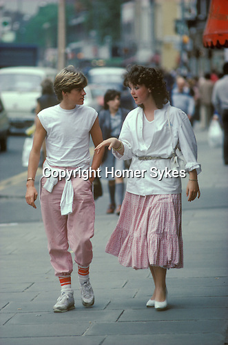 Chelsea, London, 1982<br /> A trendy a young couple in their unisex his-n-hers outfits saunter down the Kings Road on a Saturday afternoon.