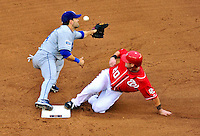 24 April 2010: Washington Nationals' infielder Adam Kennedy steals second base and goes on to third on an errant throw by Los Angeles Dodgers' catcher Russell Martin to infielder Jamey Carroll during a game at Nationals Park in Washington, DC. The Dodgers edged out the Nationals 4-3 in a thirteen inning game. Mandatory Credit: Ed Wolfstein Photo