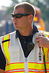 A firefighter operations officer with a radio