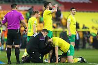 20th April 2021; Carrow Road, Norwich, Norfolk, England, English Football League Championship Football, Norwich versus Watford; Jordan Hugill of Norwich City is treated for a head injury