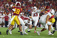 LOS ANGELES, CA - SEPTEMBER 11: Joshua Karty #43 of the Stanford Cardinal makes a point after try during a game between University of Southern California and Stanford Football at Los Angeles Memorial Coliseum on September 11, 2021 in Los Angeles, California.