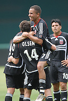DC United midfielder Ben Olsen (14) celebrates with teammates Fred (7), Jaime Moreno (99), and Christian Gomez (10) his third goal of the game in the 84th minute. Ben Olsen scored the first hat trick of his career against the NY Red Bulls. DC United defeated the New York Red Bulls, 4-2, at RFK Stadium in Washington DC, Sunday, June 10 , 2007.