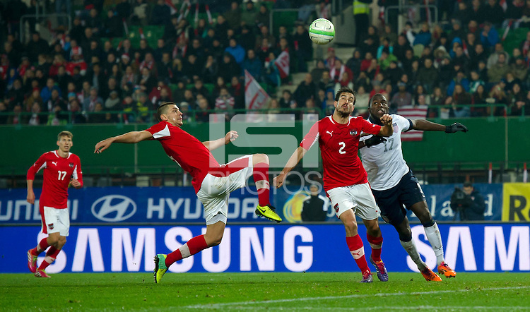 VIENNA, Austria - November 19, 2013: Jozy Altidore and Austria's Aleksandar Dragovic during a 0-1 loss to host Austria during the international friendly match between Austria and the USA at Ernst-Happel-Stadium.