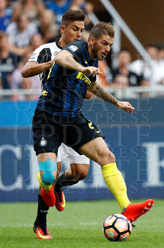 Calcio, Serie A: Inter vs Juventus. Milano, stadio San Siro, 18 settembre 2016.<br /> Inter's Davide Santon, right, is challenged by Juventus' Paulo Dybala during the Italian Serie A football match between FC Inter and Juventus at Milan's San Siro stadium, 18 September 2016.<br /> UPDATE IMAGES PRESS/Isabella Bonotto