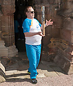 Hollywood actor and current Rector of The University of Dundee, Brian Cox, shows of his balancing skills with the Queen's Baton as he arrives at Rosslyn Chapel.