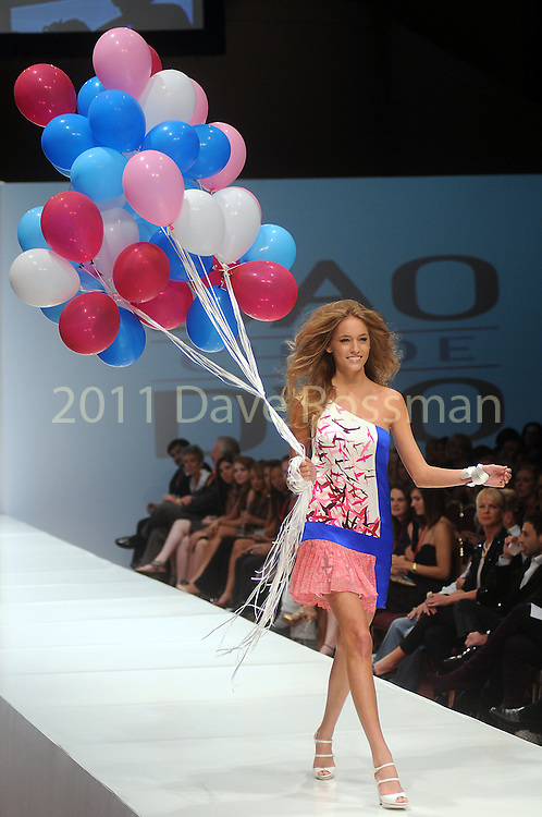 A model walks the runway during the Chloe Dao show on the third day of the Fashion Houston 2010 presented by Audi at the Wortham Theater Wednesday Oct. 13, 2010. (Dave Rossman/For the Chronicle)