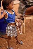 Boa Vista, Roraima State, Brazil. Yanomami girl ready to throw a stone at an intruder - illegal gold miner.