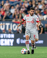 FOXBOROUGH, MA - JULY 7: Alejandron Pozuelo #10 of Toronto FC brings the ball forward during a game between Toronto FC and New England Revolution at Gillette Stadium on July 7, 2021 in Foxborough, Massachusetts.