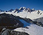 Climbers on the Upper Fox Glacier. Mount Tasman in background. Westland National Park New Zealand