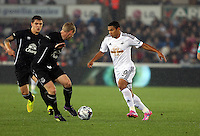 Pictured: Jefferson Montero of Swansea (R) against Tony Hibbert of Everton (2nd L). Tuesday 23 September 2014<br />