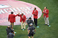 Pete Rose high fives Joe Morgan as Barry Larkin and Johnny Bench look on during the Franchise Four introductions before the MLB All-Star Game on July 14, 2015 at Great American Ball Park in Cincinnati, Ohio.  (Mike Janes/Four Seam Images)
