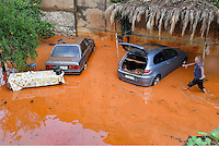 Pictured: Two cars stranded in a flooded street in Messini, near the town of Kalamata, Messinia, Greece. Wednesday 07 September 2016<br /> Re: Severe flash flooding has affected parts of Messinia County in southern Greece.