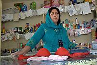 AFGHANISTAN, 06.2008, Kabul. Seltenheit: Frau als Verkaeuferin. Normalerweise haben nur Maenner Positionen inne, in denen es Kontakt zu beiden Geschlechtern gibt. Dieser Laden befindet sich in der für Frauen reservierten Zone der Hauptstadt. | Rare thing: Woman selling in the shop. Usually such position which involves contact with both sexes is reserved for men. This shop is in the women-only zone of the capital.<br /> © Marzena Hmielewicz/EST&OST
