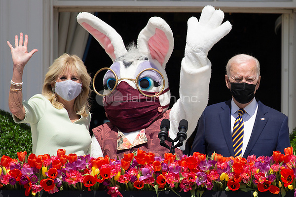 US President Joe Biden (R) stands beside First Lady Jill Biden (L) and the Easter bunny (C) after delivering remarks regarding Easter, on the Truman Balcony at the South Lawn of the White House, in Washington, DC, USA, 05 April 2021. The traditional Easter Egg Roll at the White House with thousands of visitors was not held due to the coronavirus COVID-19 pandemic.<br /> Credit: Michael Reynolds / Pool via CNP /MediaPunch