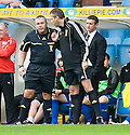 DUNFERMLINE MANAGER JIM MCINTYRE WATCHES AS FOURTH OFFICIAL IAIN BRINES HAS A WORD WITH REFEREE BRIAN WINTER BEFORE BEING SENT TO THE STAND