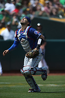 OAKLAND, CA - AUGUST 22:  Robinson Chirinos #61 of the Texas Rangers chases a foul ball during the game against the Oakland Athletics at the Oakland Coliseum on Wednesday, August 22, 2018 in Oakland, California. (Photo by Brad Mangin)