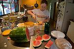 Tolga Bat Hospital volunteer Ashleigh Johnson prepares the fruits for the bats to eat.