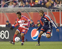 FC Dallas forward/midfielder David Ferreira (10) brings ball forward as New England Revolution defender Darrius Barnes (25) defends. The New England Revolution defeated FC Dallas, 2-1, at Gillette Stadium on April 4, 2009. Photo by Andrew Katsampes /isiphotos.com