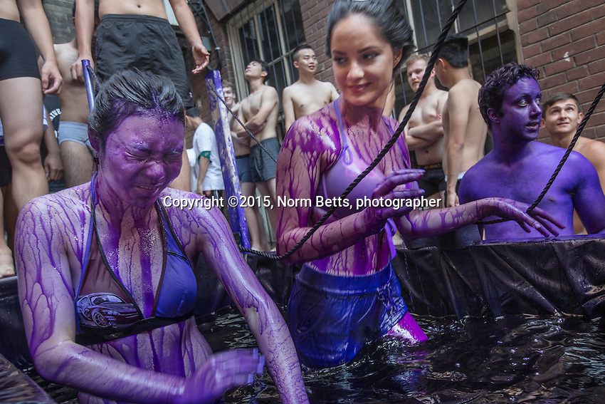 FIRSY DAY AT UNI  - First year students  in The University of Toronto's dept. of engineering traditionally are dyed purple…. by upper class engineers.... the dye scrubs off in about a week.<br /> First year engineering students, Cynthia Jingi (left) and Olivia Aljoundi, emerge from dunking themselves in a tank of purple dye.<br />  <br /> normbetts@canadianphotographer.com<br /> 416 460 8743