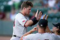 Center fielder Kellen Strahm (33) of the Hickory Crawdads is greeted after scoring a run in a game against the Greenville Drive on Wednesday, June 16, 2021, at Fluor Field at the West End in Greenville, South Carolina. (Tom Priddy/Four Seam Images)