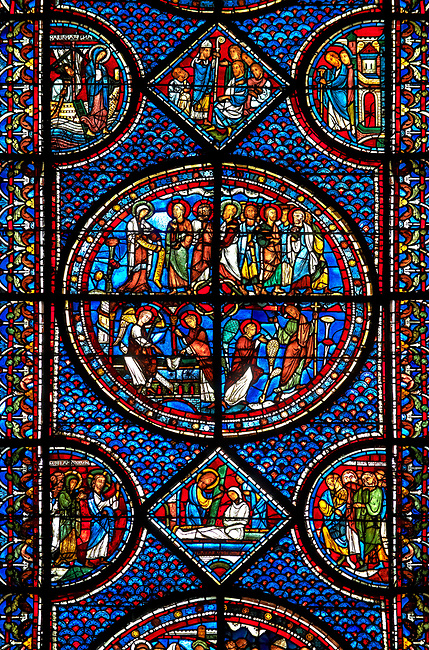 Medieval stained glass Window of the Gothic Cathedral of Chartres, France - dedicated to the Life of St Mary Magdalen. Central panel - bottom left - Mary meets the angel at Christ's empty tomb (the Quem quaeritis), bottom right - The Noli me tangere, top left - Mary as the Apostola Apostolorum , top right - The Apostles receiving Mary's news . Diamond below and side panels either side - Christ raising Lazarus. A UNESCO World Heritage Site.