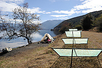 CHINA Yunnan Lugu Lake, fisherman in tent with shields to dry fish  /CHINA Provinz Yunnan , Lugu See, Fischer in Zelt am See und Vorrichtung zur Trocknung von Fisch