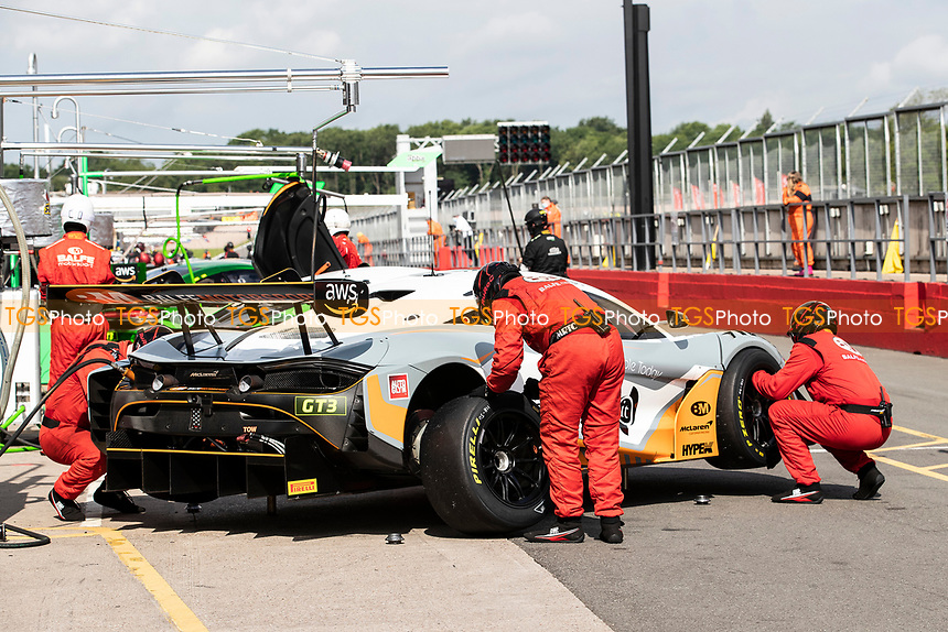 The pit crew for Stewart Proctor & Lewis Proctor, McLaren 720S GT3, Balfe Motorsport fix the tyres during the British GT & F3 Championship on 11th July 2021