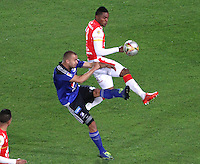 BOGOTA - COLOMBIA - 6-09-2015: Miguel Borja jugador de Independiente Santa Fe  disputa el balon con   Andres Cadavid de Millonarios     durante partido  por la fecha 10 de la Liga Aguila II 2015 jugado en el estadio Nemesio Camacho El Campin. / Miguel Borja player of Independiente Santa Fe   fights the ball against Andres Cadavid  of Millonarios   during a match for the tenth  date of the Liga Aguila II 2015 played at Nemesio Camacho El Campin stadium in Bogota  city. Photo: VizzorImage / Felipe Caicedo / Staff.