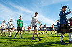 The teams march behind the band before the county senior football final at Cusack Park. Photograph by John Kelly.