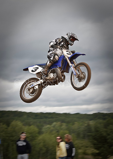 Motocross racer getting big air over a jump