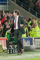 Wednesday 4th  December 2013 Pictured: Manager of Wales, Chris Coleman  Celebrates the Welsh win on the final whislte Re: UEFA European Championship Wales v Cyprus at the Cardiff City Stadium, Cardiff, Wales, UK