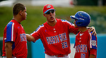 ABERDEEN, MD - AUGUST 02: Coach Mahyko Torres #23 of Puerto Rico talks with Kennel Rosado #10 of Puerto Rico and Francisco Santiago #19 of Puerto Rico in the 1st inning during a game between the Dominican Republic and Puerto Rico during the Cal Ripken World Series at The Ripken Experience Powered by Under Armour on August 2, 2016 in Aberdeen, Maryland. (Photo by Ripken Baseball/Eclipse Sportswire/Getty Images)