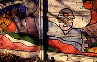 Milano 1970.Murales realizzato sui muri di una fabbrica nel quartiere Affori sui temi della lotte operaie e le conquiste sociali. .Foto Livio Senigalliesi