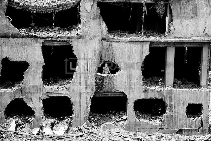 A rescue worker looking at the ruins of the Rana Plaza building collapse in Savar, near Dhaka, Bangladesh