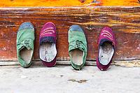 Matang, a Gejia Village in Guizhou, China.  Shoes Drying outside a House.