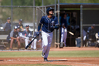 San Diego Padres third baseman Fernando Tatis, Jr. (23) starts down the first base line during an Instructional League game against the Milwaukee Brewers on September 27, 2017 at Peoria Sports Complex in Peoria, Arizona. (Zachary Lucy/Four Seam Images)