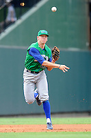 Third baseman Hunter Dozier (13) of the Lexington Legends fields a grounder in a game against the Greenville Drive on Friday, August 18, 2013, at Fluor Field at the West End in Greenville, South Carolina. Dozier was the No. 1 pick (eighth overall) by the Kansas City Royals in the first round of the 2013 First-Year Player Draft. He played collegiate ball for Stephen F. Austin University. Lexington won, 5-0. (Tom Priddy/Four Seam Images)