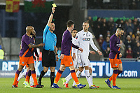 Aymeric Laporte of Manchester City (C) sees a yellow card by referee Andre Marriner during the Emirates FA Cup match between Swansea City and Manchester City at the Liberty Stadium, Swansea, Wales, UK. Saturday 16 March 2019