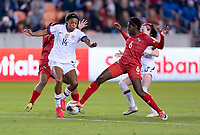 HOUSTON, TX - JANUARY 31: Jess McDonald #14 of the United States is tackled by Maria Murillo #6 of Panama during a game between Panama and USWNT at BBVA Stadium on January 31, 2020 in Houston, Texas.